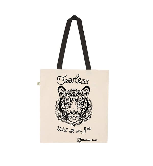 Organic tote bag with a tiger on it and the text fearless until all are free