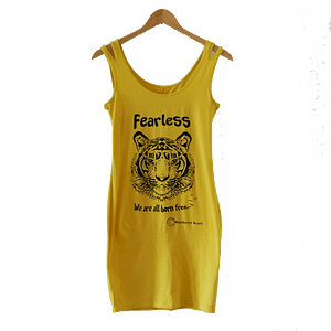 yellow vintage dress with tiger screenprint and feraless we are all born free written on it
