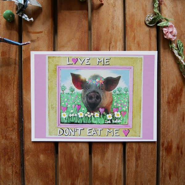 bamboo postcard with a little pig with flowercrown and the text love me don't eat me written on it vegan