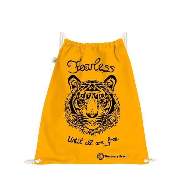 Organic gym bag with tiger screen print and the text fearless until all are free written on it