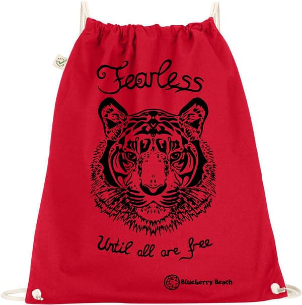 Organic gym with tiger screen print and the text fearless until all are free written on it