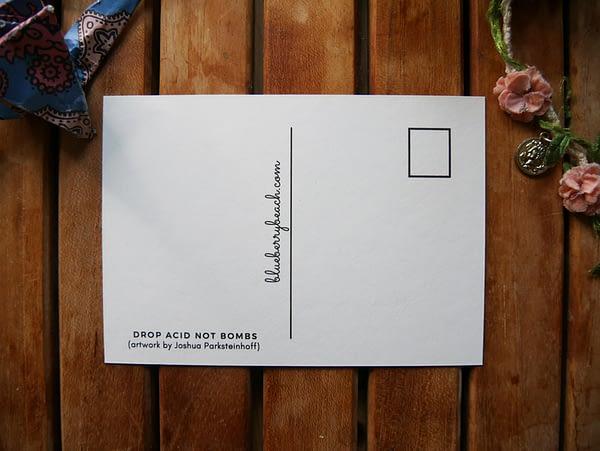 drop acid not bombs back of postcard